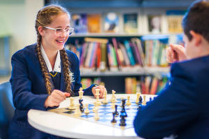 Two students at Clancy Catholic College West Hoxton playing chess in the library