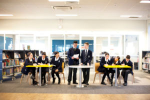 Students debating in school library at Clancy Catholic College West Hoxton