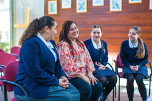 Mother and her three daughters at Clancy Catholic College West Hoxton in school chapel