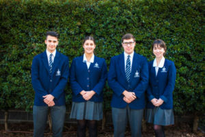 Four Clancy Catholic College West Hoxton students standing and smiling to camera