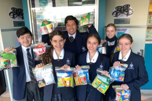 Students at Clanyc Catholic College creating care packs for Vinnies Night Patrol