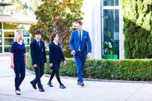 Principal and Assistant Principal of Clancy Catholic College West Hoxton walking with students