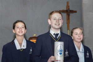 Three Clancy Catholic College West Hoxton students carrying school candles in school chapel