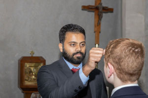 Student at Clancy Catholic College West Hoxton receiving blessing from staff in school chapel