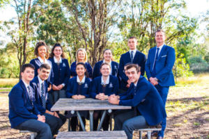 Student leadership team with principal and assistant principal at Clancy Catholic College West Hoxton