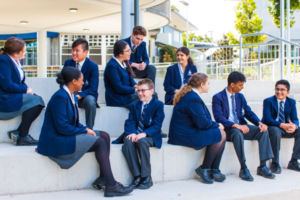 Students at Clancy Catholic College sitting and chatting on steps