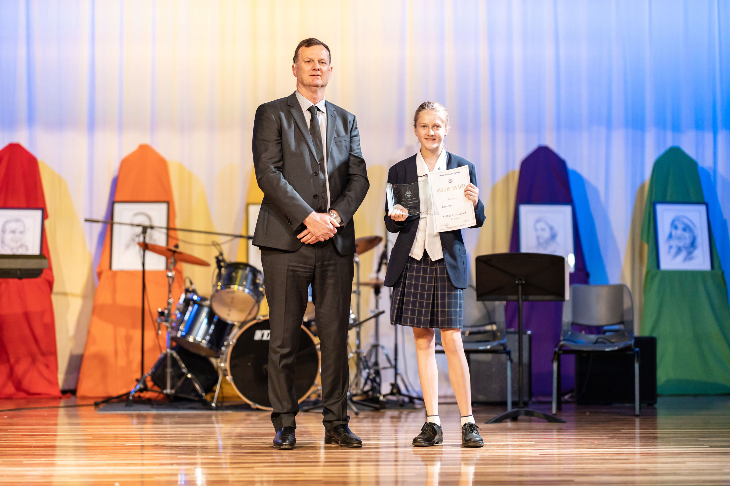 principal with student on stage